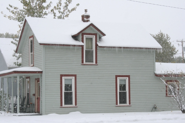 Icicles forming on a neighbor's house