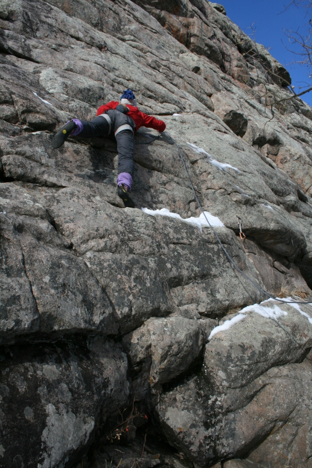 Phil mantles off of a snowy ledge.