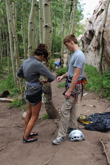 Matt helps Libby saddle up at Beehive Buttress