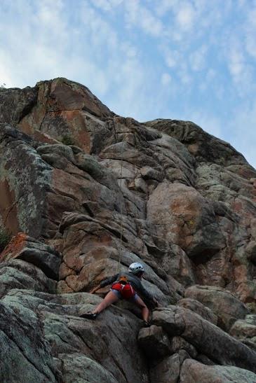 Libby climbing a 5.8