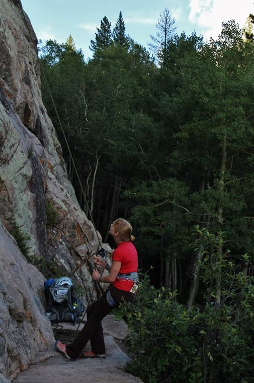 Me belaying my brother Ben up a climbing route in Medicine Bow National Forest