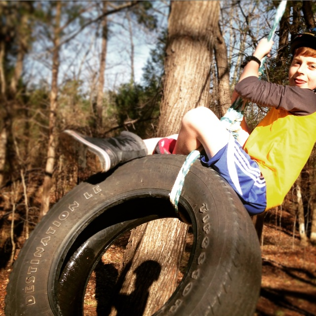 Sam enjoys the tire swing