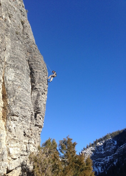 Kyle rappelling down after competing a climb at American Fork