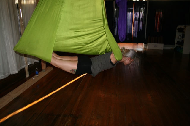 Aerial yoga instructor Jessie Quinn doing some weird & awesome stuff